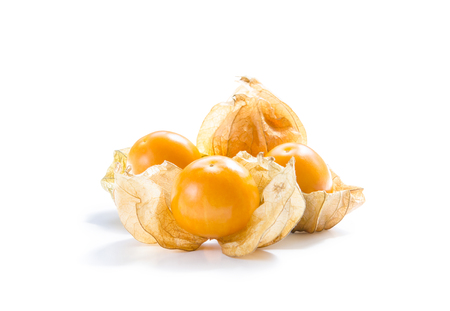 Close-up fresh pichuberry (Cape Gooseberry), very delicious and healthy berry fruit, uchuva isolated on white background with shadow and sunlight at the back