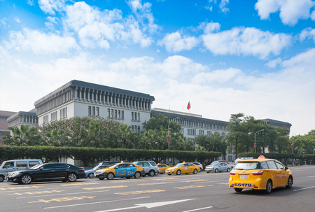 TAIPEI, Taiwan - February 14, 2012: Yellow taxi cap passing Ministry of Foreign Affairs, Taiwan (Republic of China) located on Ketagalan Blvd, Zhongzheng District in Taipei City