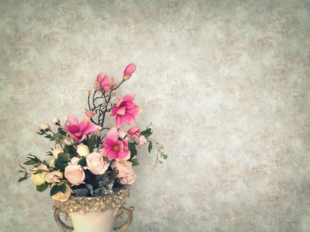 antique vase: Vintage old wall background with grain texture decorated with pink flowers and roses in antique vase with copy space for text decoration and insertion Stock Photo