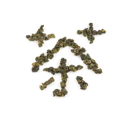 Fresh Tieguanyin Oolong tea leaves arranged as tea in Chinese or Taiwanese word on white background for hot or cold drinks