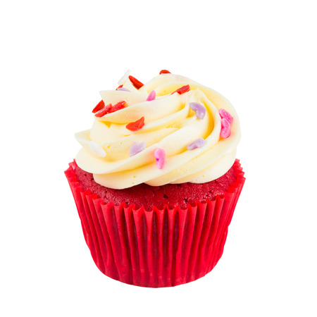 Red Velvet Cup Cake topped with red, purple, pink heart shaped icing isolated on white background