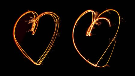 Sparkler light painted in shape as two hearts at night time