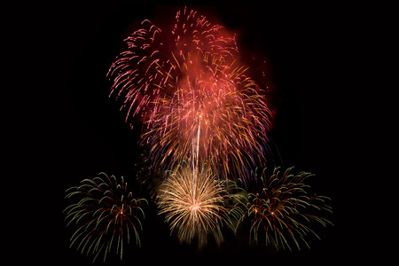 Colourful Fireworks at night over dark sky to celebrate New Year eve and special occasion on holidays Stock Photo