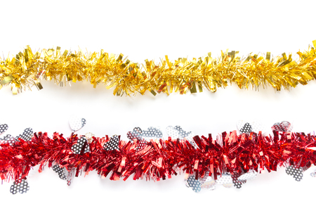 Gold yellow and red tinsels on white background, Christmas decorative ornament for special holiday celebration