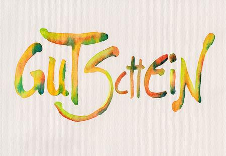 translates: Handwritten german text Gutschein translates into voucher watercolor painting