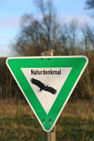 translates: German sign Naturdenkmal translates into Natural monument