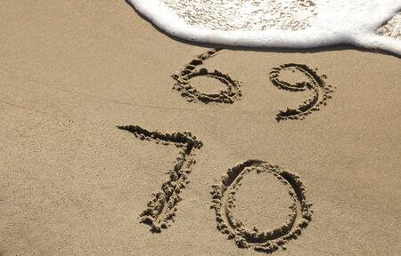 ビーチで 70 周年 写真素材