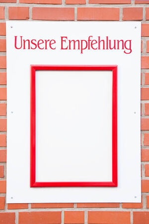 translates: German restaurant menu sign with the text Unsere Empfehlung translates into Our recommendation in English language