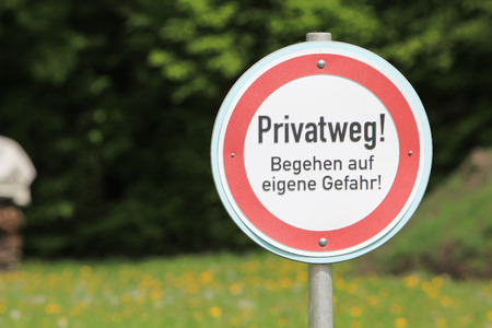do not enter warning sign: Private road sign in German language