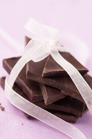 close p: Dark chocolate candy with ribbon