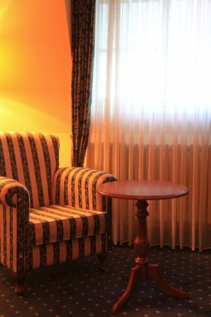 comfortable: Comfortable armchair at window Stock Photo