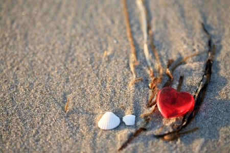 plastic heart: Red plastic heart on the beach