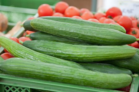 Cucumber and tomato on farmers market