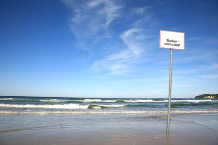 no swimming: Sign on the beach reading \Baden verboten\ which translates into \No swimming\ in English language