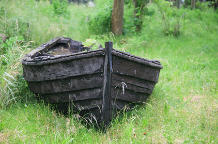 Old row boat in the front yard Stock Photo