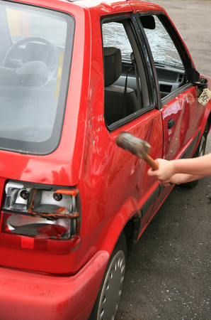 vandalism: Vandalism with a hammer on a car Stock Photo
