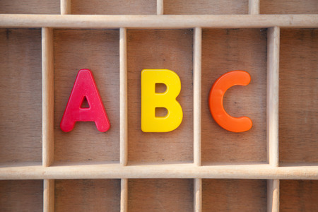 letter case: Alphabet letters in a wooden letter case Stock Photo