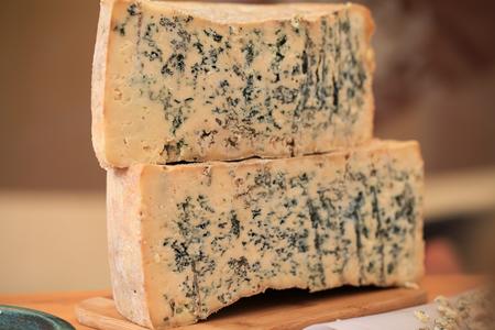 gorgonzola: Sliced Gorgonzola or Roquefort cheese loaf Stock Photo