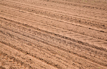 ploughed: Agricultural ploughed field pattern background Stock Photo