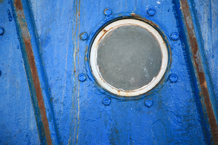 Detail of an old passenger ship with a porthole Stock Photo