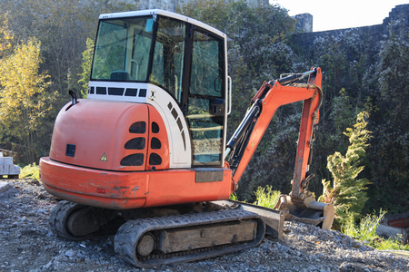 Small excavator on construction site