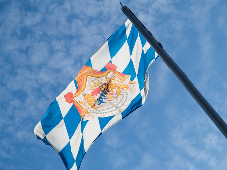Bavarian flag in front of a summer sky Standard-Bild