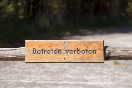 Retro wooden sign with the German text