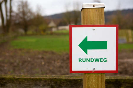 """Directional sign with the German text """"Rundweg"""" which translates into """"Circular walk"""" in English language Reklamní fotografie"""