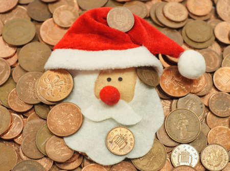 A flurry Santa face amongst coins                           Stock Photo