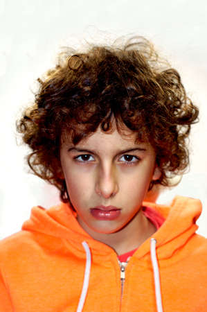 A portrait of a young handsome Caucasian boy with curly hair