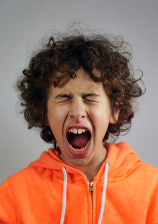 Young boy is in a shouting gesture