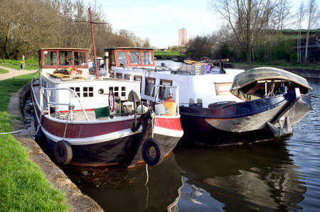 Houseboats docked next two each other in a London canal