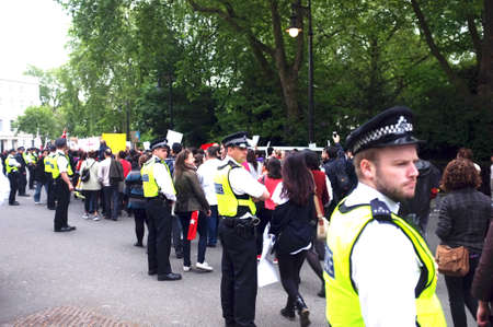 London Police is escorting demonstrators after a rally in London