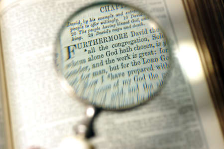 bible altar: Magnifier on a bible page Editorial