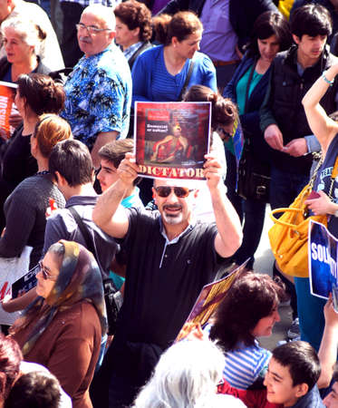 objection: Turkish protester holds a sign during a political demo