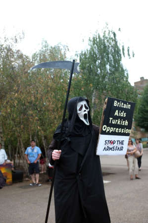 Scream-masked protester during a demo