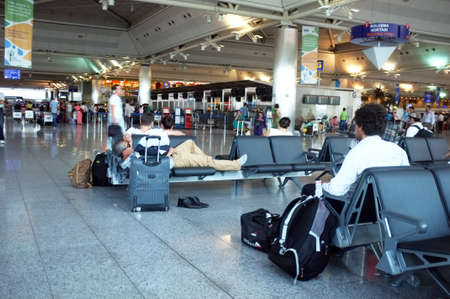 delays: Indoor view from a busy airport Editorial