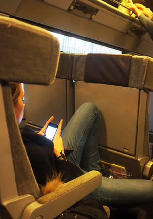 eurostar: Teenager plays with her phone Editorial