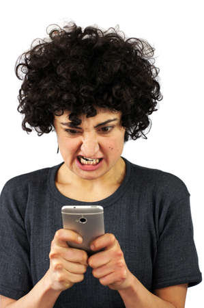 Angry woman looks at her phone