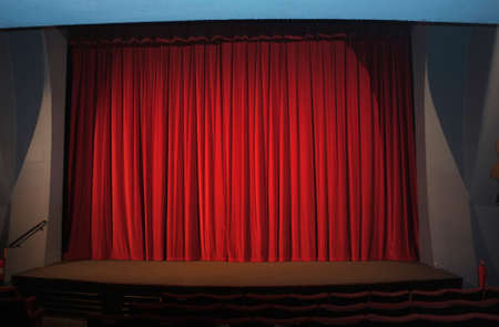 Close red curtains in an empty theater with no spectators photo