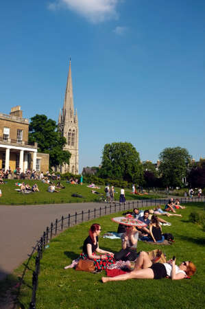 british weather: Londoners enjoy the sunny British weather in a local park in London  Editorial