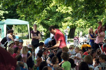 treed: Man entertains children during the celebration of 125th years of Clissold Park in North London  Editorial