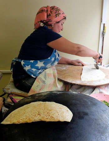 turkish woman: Turkish woman cooking pastry