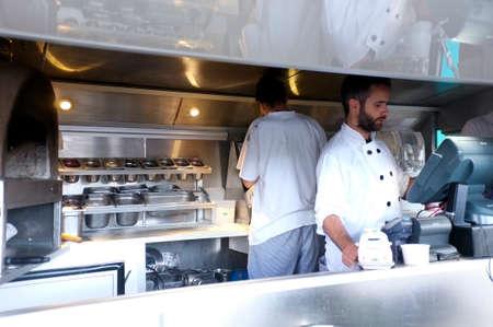 Staff work on a pizza vendor