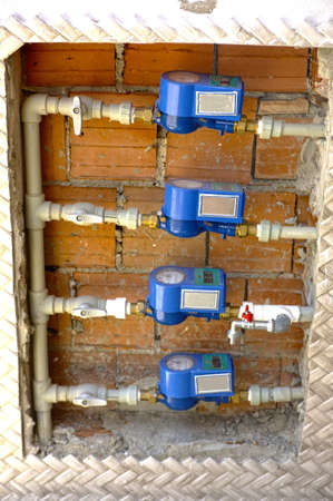 gas meter: Gas meter bank outside of  house Stock Photo