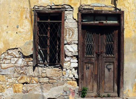 Old wooden vintage door and window in ruin photo