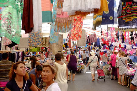illegal trading: People in outdoor market