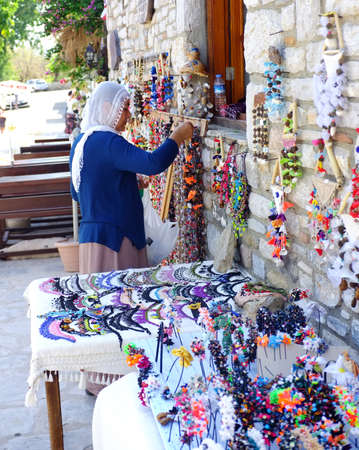 tradeswomen: Village woman preparing her local stall Editorial