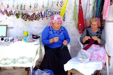tradeswomen: Village women selling their creation Editorial