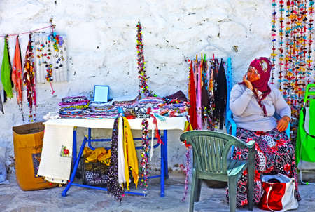 tradeswomen: Village woman selling hand-knitted gifts